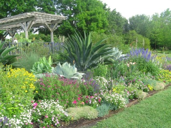 Colors and textures add contrast to this border garden.